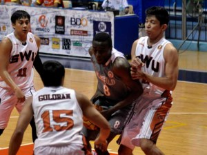 Rodrigue Ebondo muscles his way against SWU for 18 points and nine rebounds.  (photo courtesy of Dante Peralta)